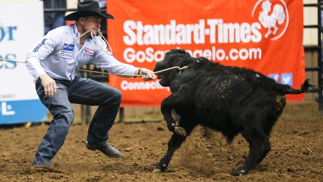 Sterling Smith catches a calf for tie down during the 4th performance of the San Angelo Stock Show and Rodeo Sunday, Feb. 4, 2018, at Foster Communications Coliseum.