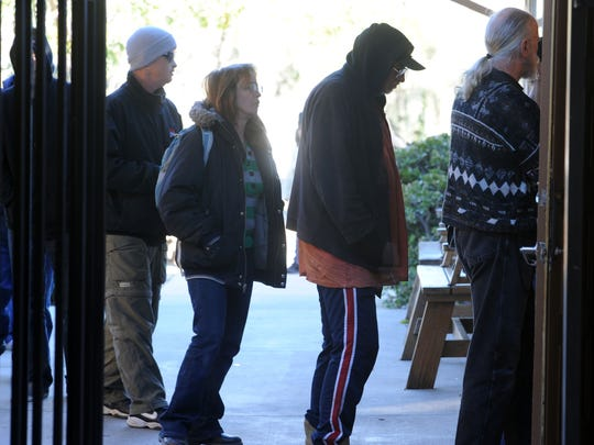 Homeless people line up for breakfast in Simi Valley.