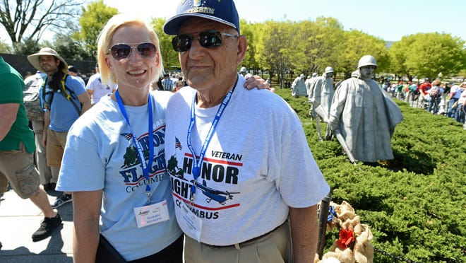 Korean War Air Force veteran Lloyd Anderson of Marion and his daughter, Susan Schupp, pose for a photo at the Korean War Memorial on Saturday, April 18. He and 80 other veterans from WWII, the Korean War and the Vietnam War took part in the Honor Flight Columbus trip to Washington, D.C. The trip allows veterans a chance to see the memorials in the capital free of charge.
