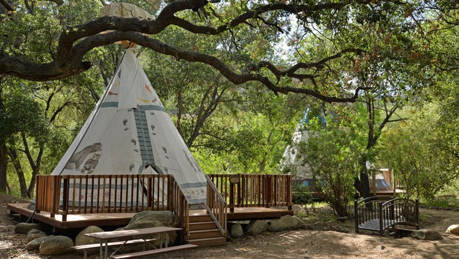 Turn a teepee into glamping with Ventura Ranch KOA's glamour tent option.