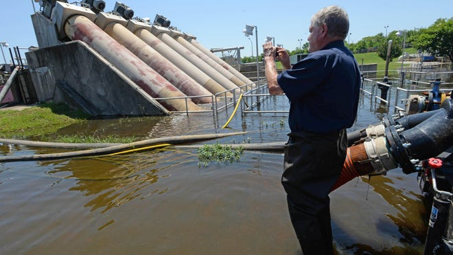 Randy Smith, plant manager of Shreveport's North Regional Wastewater Plant snaps a photo of the influent pumps with his smartphone while he and his crew keep the pumps running through the flood emergency. Currently three of the six pumps are down. Two went offline before the flood and one during the flood.