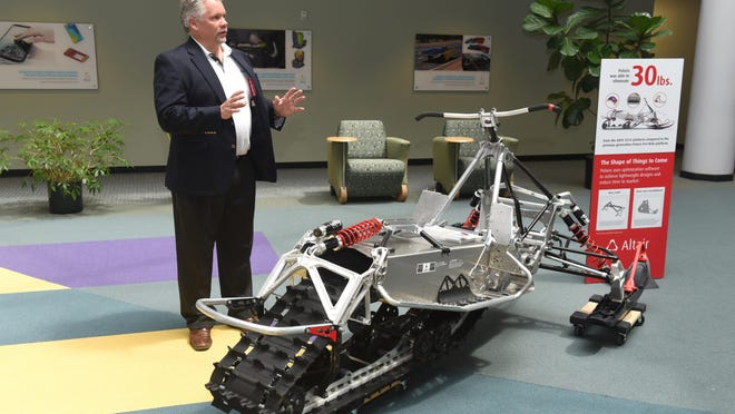 Altair's chief marketing officer, Jeff Brennan, shows a platform for Polaris snowmobiles at company headquarters in Troy.