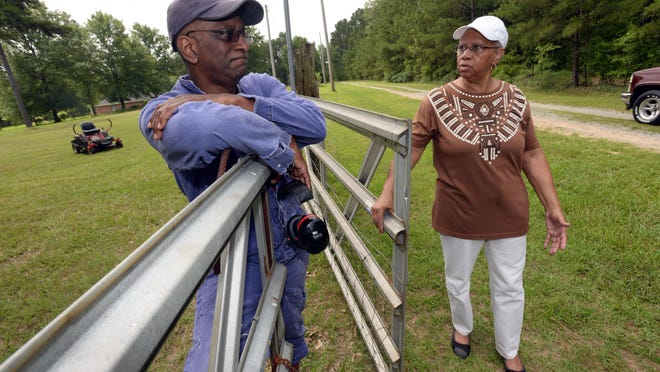 Nathaniel Petterway and his sister, Lannie Hudson, both own property along Dawson Road. Petterway says he is unable to finance a mortgage for a home until a road is built.