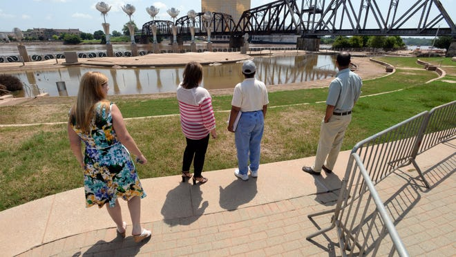 State and federal officials are escorted around Riverview Park while touring areas of flood damage in Shreveport and Bossier City.