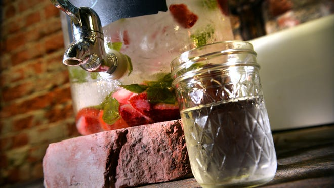 Strawberry and basil infused water is one flavor served to customers at Joseph Guin Salon.