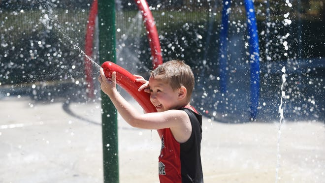 Joshua Janes, 6, cools off in the water at Wildwood Splash Park on Wednesday, July 1, 2015, in Aumsville.