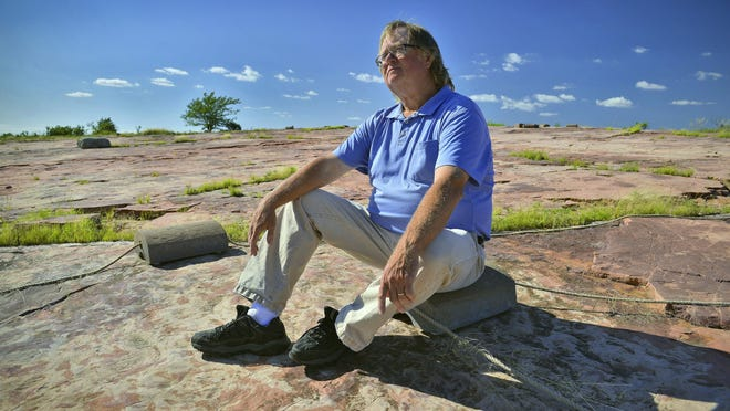 Tom Sanders, site manager at Jeffers Petroglyphs historic site, talks July 21 about the 5,000 or so ancient carvings that have been found etched into the stone at the site in Cottonwood County. He highlights stories that illustrate Native Americans' advances in geometry, math and science. Jeffers remains one of the oldest continuously used sacred sites in the world.