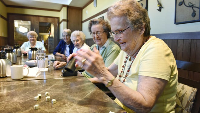 Jackie Conroy plays in the weekly Farkle dice game with friends Tuesday at Country Manor Campus in Sartell.