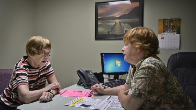 Val Young, right, lead independent living specialist at Independent Lifestyles, Sauk Rapids, talks with consumer Ramona Wise, Waite Park, Tuesday at Independent Lifestyles. Through Independent Lifestyles' Real-Time Resources program, clients can get help with everyday tasks like paying bills, budgeting, or filling out forms.