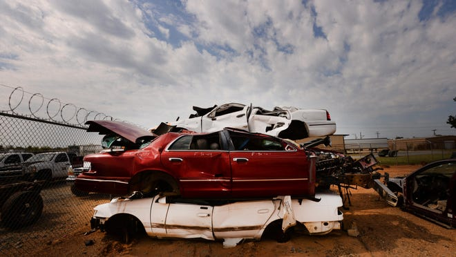 Cars pile up at Aero Auto Salvage where often cars that are in accidents end up at.