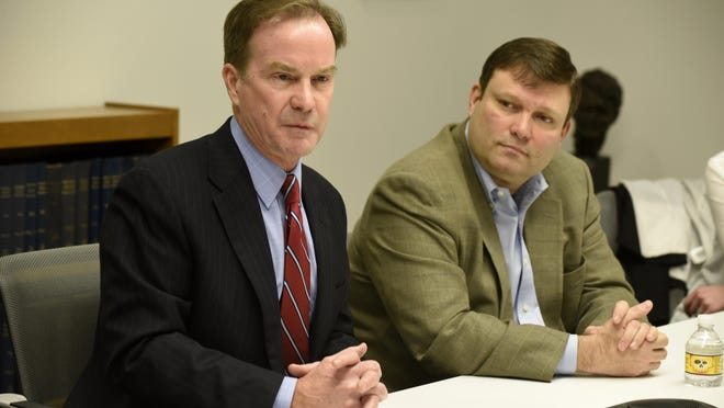 Andy Arena, the FBI Detroit office's former director, right, appears with then-Michigan Attorney General Bill Schuette.