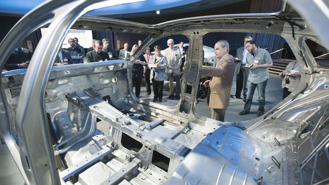 Warren Parsons, GM Global Chief Architect for Body Structure describes the light weighting strategies utilized on a Cadillac CT6 during a press conference at the Design Dome on May 18, 2016.