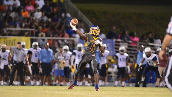 Rickards' Ferante Cowart attempts a pass against East Gadsden during the first half of their game Friday night at Rickards home field.