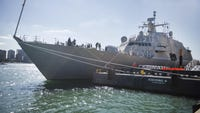 The new Freedom-class littoral combat ship powered along the Great Lakes on Friday to dock in Detroit