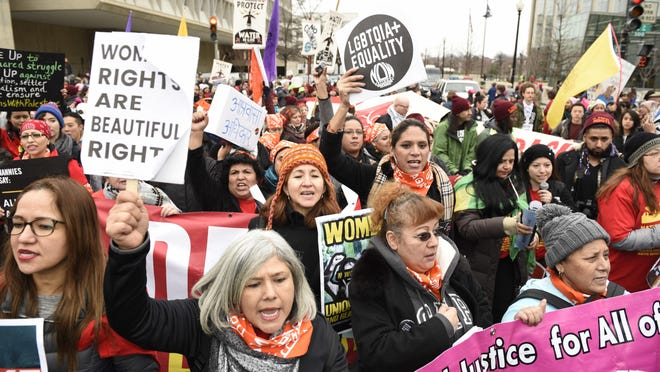 Participants attend the Women's March on Washington on Jan. 21 in Washington. Thousands of women massed in the nation's capital and cities around the globe Saturday to send Donald Trump an emphatic message that they won't let his agenda go unchallenged over the next four years.