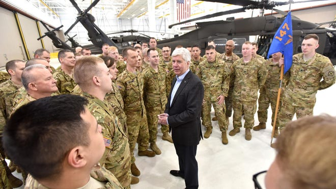 Gov. Rick Snyder chats with the men and women of the 147th Attack Helicopter Battalion before they leave their Grand Ledge base for deployment overseas. For some of the unit's members, this is their fourth deployment.