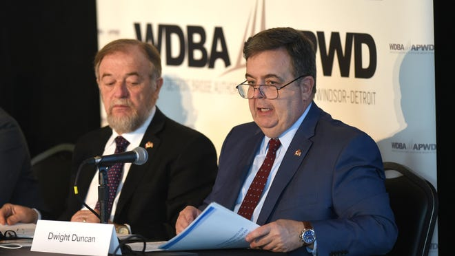 Michael Cautillo, president and CEO of the Windsor-Detroit Bridge Authority, left, and Dwight Duncan, interim chair of the Windsor-Detroit Bridge Authority board, address the annual public meeting at Michigan Outdoor Adventure Center Friday in Detroit.