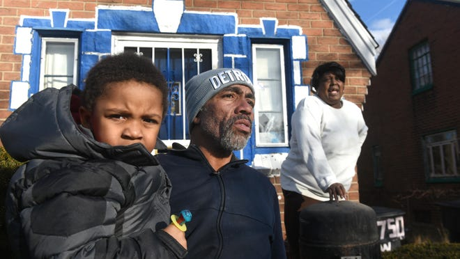 Richard Johnson Jr. holds his son Richard Johnson III outside the home of Latasha Tucker who faced eviction from a house filled with significant health hazards in this file photo from February 16, 2017. Johnson tried to help Tucker stem frequent sewage backups in her basement. Her landlord snaked the drain, but the problem persisted and she ceased paying rent, which led to an eviction bid that was eventually dropped when she agreed to move out.