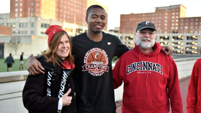 Gary Clark takes time to take photographs with Bearcats fans Sunday, March 34th at the University of Cincinnati