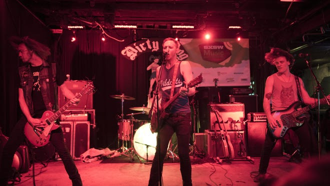Austin-based Not In The Face performs at Dirty Dog Bar during SXSW 2014.
