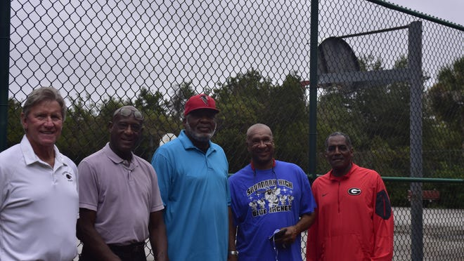 Former Armstrong State College basketball players (left to right) Lamar Kirkley, Ike Williams, Sonny Powell and Roney Clark, and former Savannah High School standout Lawrence Bryan III got together recently at the basketball courts in Daffin Park to reminisce about Sam Berry.