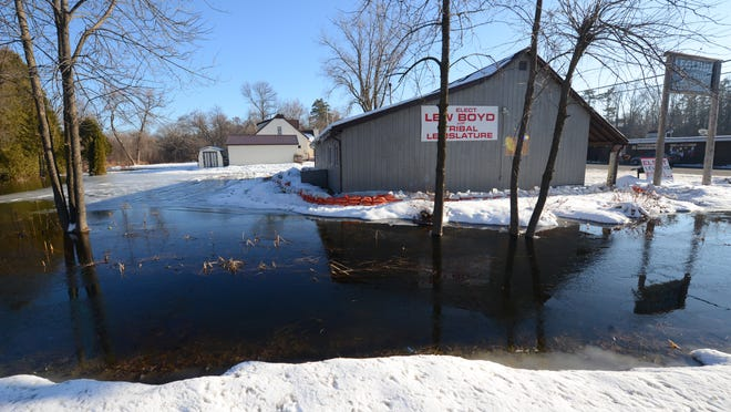 Businesses in Keshena began taking steps last week to protect their buildings as the waters of the Wolf River rise.