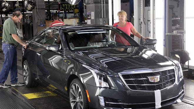Workers at the GM Lansing Grand River plant inspect a Cadillac ATS in this 2015 file photo. The ATS and CTS will likely be replaced by the Cadillac CT5 after 2019.