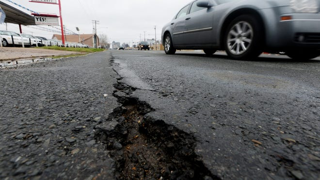 A motorists misses a pothole on Louisiana Highway 1 north of Shreveport. Deteriorated roads and aged bridges, such as the one in this picture, need maintenance, but Louisiana has a $12 billion backlog in projects.