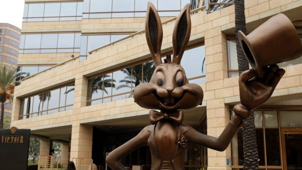 A statue of Warner Bros. character Bugs Bunny greets visitors to offices outside of Warner Bros. Studios in Burbank, California, U.S., on on Tuesday, Feb. 5, 2013. Time Warner Inc., the parent company of Warner Bros. Studios, is scheduled to release quarterly earnings data before the opening of U.S. financial markets on Feb. 6. Photographer: Patrick T. Fallon/Bloomberg via Getty Images