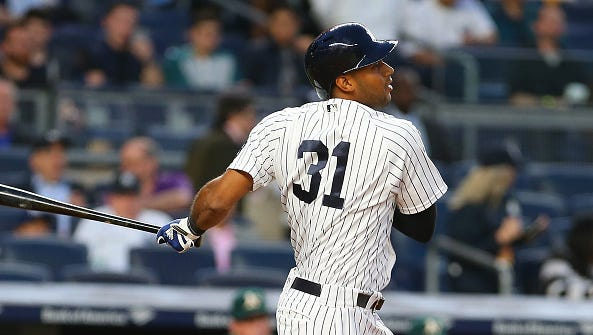 NEW YORK, NY - APRIL 21: Aaron Hicks #31 of the New York Yankees hits a RBI single in the second inning against the Oakland Athletics at Yankee Stadium on April 21, 2016 in the Bronx borough of New York City.