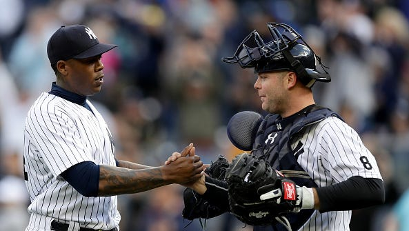 Aroldis Chapman and Brian McCann of the New York Yankees celebrate the win after the game against the Chicago White Sox at Yankee Stadium on May 15, 2016 in the Bronx borough of New York City.The New York Yankees defeated the Chicago White Sox 7-5.