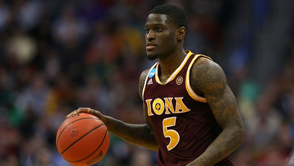 A.J. English of the Iona Gaels drives the ball against the Iowa State Cyclones  during the first round of the 2016 NCAA Men's Basketball Tournament at the Pepsi Center on March 17, 2016 in Denver, Colorado.