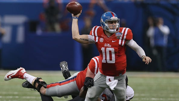 Quarterback Chad Kelly looks to throw the ball as he is tackled during the Sugar Bowl. Experts believe he needs to cut down on the number of chances he takes during games.