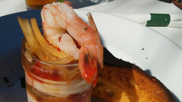 12A Buoy's pickled shrimp is served in a miniature mason jar and comes with a toasted baguette.