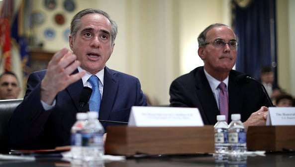 Veterans Affairs Secretary David Sulking, left, testifies before the House Veterans Affairs Committee about ongoing reforms at the VA with VA Inspector General Michael Missal in the Cannon House Office Building on Capitol Hill on March 7, 2017, in Washington, D.C.