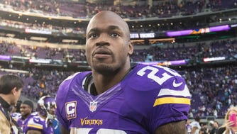 Minnesota Vikings running back Adrian Peterson (28) looks on following the game against the Indianapolis Colts at U.S. Bank Stadium.