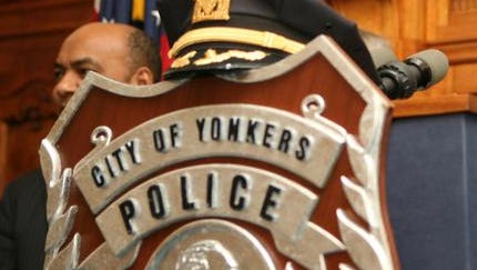 Photo of Yonkers police badge and  uniform hat at a police promotion ceremony at Yonkers City Hall, Jan. 31, 2013.  ( Mark Vergari/The Journal News )