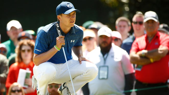 Jordan Spieth lines up a putt on the 1st green during the third round of the Masters.