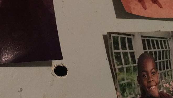 One of several bullet holes in the walls of Latarsha McKee's house after a shooting Tuesday morning.