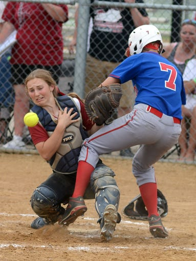 Scott County's Katie Stamper is safe at home plate as McCracken County catcher Rachel Ridolfi loses the ball Saturday at the Worth/KHSAA Softball State Tournament in Owensboro. June 7, 2014