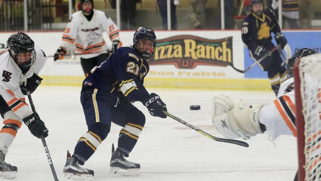 Wausau West forward Nick Techel  shoots on goal against the West Salem Panthers in a quarterfinal match at the WIAA state boys hockey tournament t at Veterans Memorial Coliseum earlier this month.