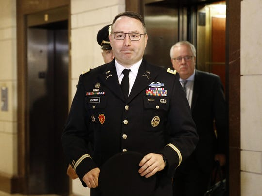 FILE - In this Oct. 29, 2019, file photo, Army Lt. Col. Alexander Vindman, a military officer at the National Security Council, center, arrives on Capitol Hill in Washington. Vindman is set to deliver public testimony about President Donald Trump's alleged attempt to pressure Ukraine to investigate a political rival. Democrats and Republicans are expected to press contrasting narratives about the 20-year Army veteran's decision to come forward to allege abuse of power by his commander-in-chief. (AP Photo/Patrick Semansky, File)