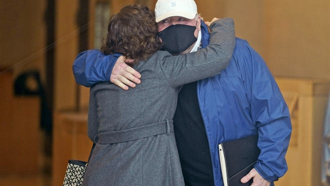 Michael Skakel hugs someone as he arrives to a courthouse in Stamford, Conn. on Friday.  Prosecutors decided not to retry Skakel, a Kennedy cousin, is for the bludgeoning death of a fellow teenager in 1975.