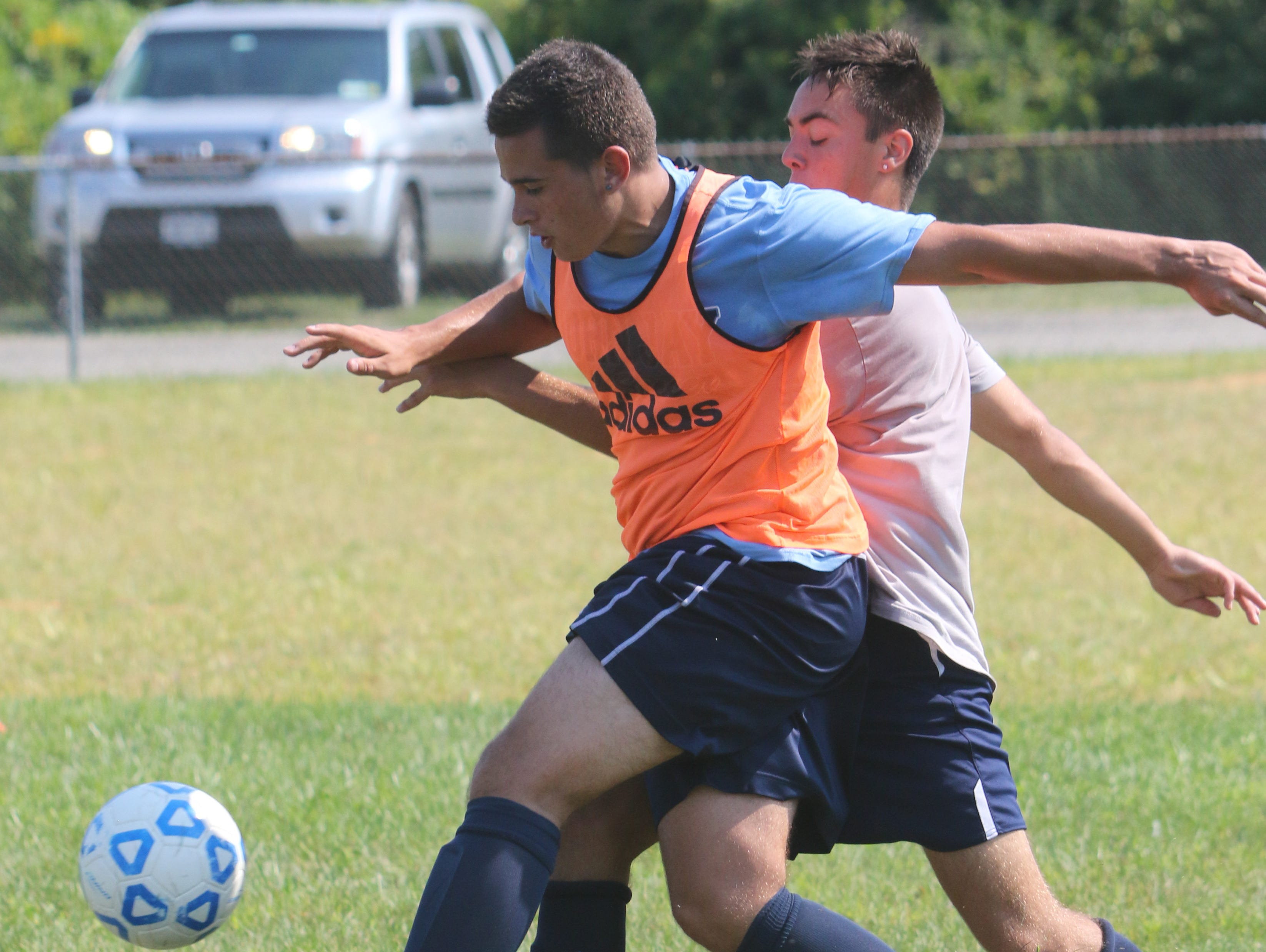 John Jay High School's Luke Melvin attempts to keep possession of the ball during practice on Wednesday.
