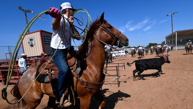 """Heeler Bailey Springer chases after a calf, waiting for """"header"""" A.P. Jones to rope the animal around the neck or horns, so he can rope the back feet. Friday was the Gideon Carmichael Memorial Team Roping at the Wild Horse Prairie Days in Haskell June 1, 2018."""