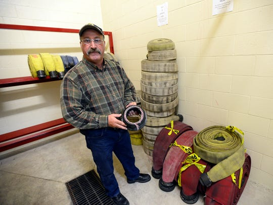 Chief Doug Crowell with the Ballville Volunteer Fire Department shows fire hoses that have been placed out of service.