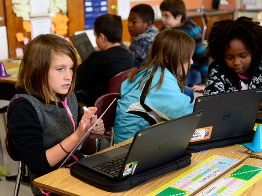 Fourth graders, from left, Chloe Puckelwartz, 10, Ella Rhodes, 9, and Amira Chambers, 9, work on their Chromebooks recently at West Pensacola Elementary School.