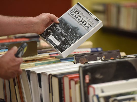 Books range from 50-cent paperbacks to rare first editions.