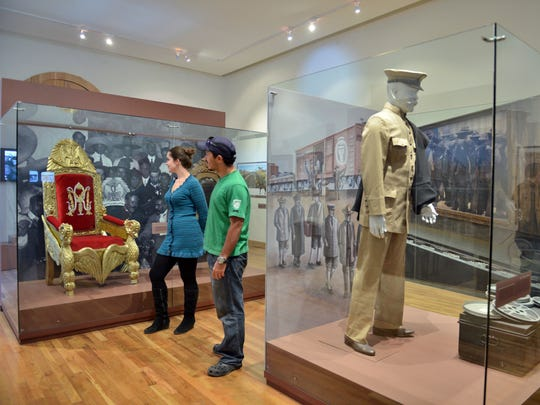 This undated photo provided by the Mexico Tourism Board and Fideicomiso ¡Ah-Chihuahua! shows visitors looking at a chair on display at the Museum of the Revolution in the Border in Ciudad Juarez, Mexico. The museum tells the story of the revolution, a turbulent chapter of history that lasted from 1910 to 1920 and transformed Mexican society. The chair is part of an exhibit showing where revolutionary leaders Pancho Villa and Emiliano Zapata sat at the National Palace after attacks on Mexico City.