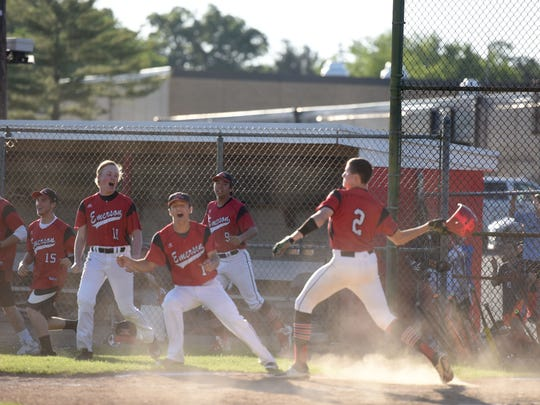 Emerson team celebrate victory Emerson hosts the North 1, Group 1 sectional baseball final against rival Park Ridge